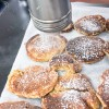 Sprinkling icing sugar on pancakes working with Mairlyn Smith on eatlivetravelwrite.com