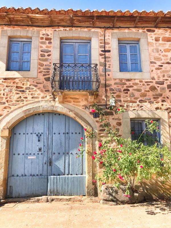 Blue door in Santa Catalina Walking the Camino de Santiago: Astorga to Rabanal del Camino with Camino Travel Center on eatlivetravelwrite.com