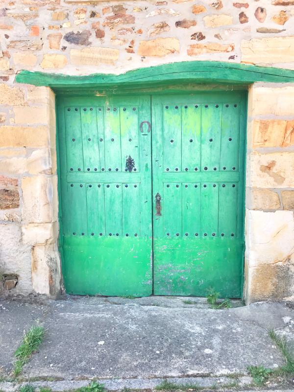 El Ganso green door Walking the Camino de Santiago: Astorga to Rabanal del Camino with Camino Travel Center on eatlivetravelwrite.com