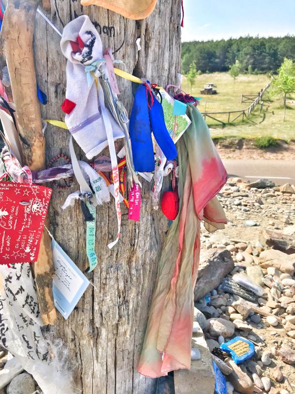 Souvenirs at the Cruz de Ferro walking the Camino de Santiago: Rabanal del Camino to El Acebo with Camino Travel Center on eatlivetravelwrite.com