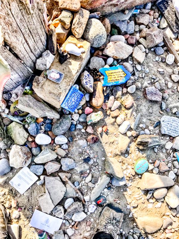 Souvenir stones at the Cruz de Ferro walking the Camino de Santiago: Rabanal del Camino to El Acebo with Camino Travel Center on eatlivetravelwrite.com