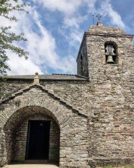 Church in O Cebreiro with bell tower walking the Camino de Santiago: Las Herrerías to O Cebreiro with Camino Travel Center on eatlivetravelwrite.com