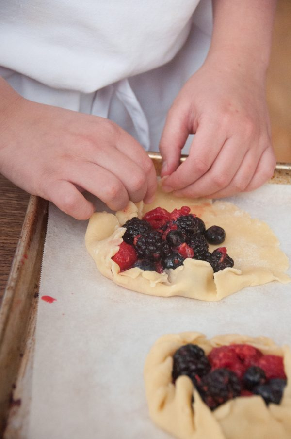 Kids making fruit galettes from In the French kitchen with kids on eatlivetravelwrite.com