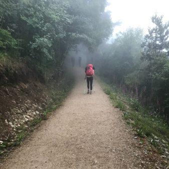 Pilgrims in the mist walking the Camino de Santiago: O Cebreiro to Triacastela with Camino Travel Center on eatlivetravelwrite.com