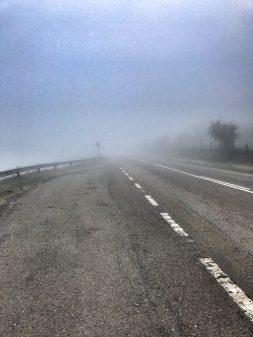 Roads covered in mist walking the Camino de Santiago: O Cebreiro to Triacastela with Camino Travel Center on eatlivetravelwrite.com
