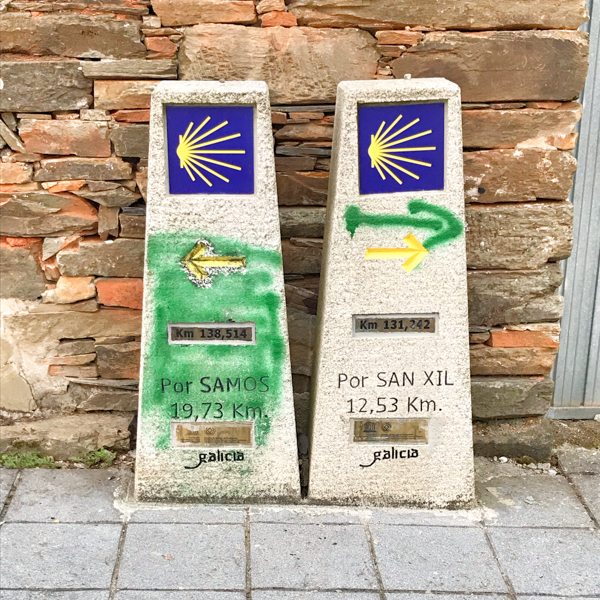 Signposts along the way in Triacastela walking the Camino de Santiago: Triacastela to Sarría with Camino Travel Center on eatlivetravelwrite.com
