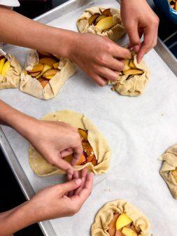 Finishing assembling galettes kids make Fall-Market Galette from Dorie Greenspan's Baking Chez Moi for Tuesdays with Dorie on eatlivetravelwrite.com