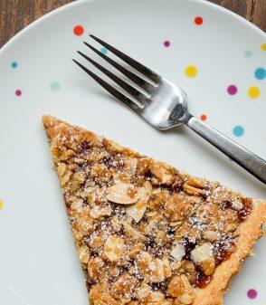 Slice of Jam Crumble Tart on eatlivetravelwrite.com