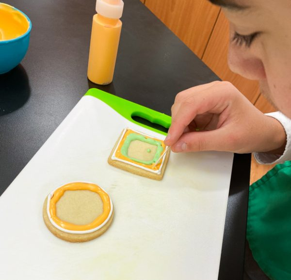 Careful flooding work decorating sugar cookies with Adell Shneer on eatlivetravelwrite.com