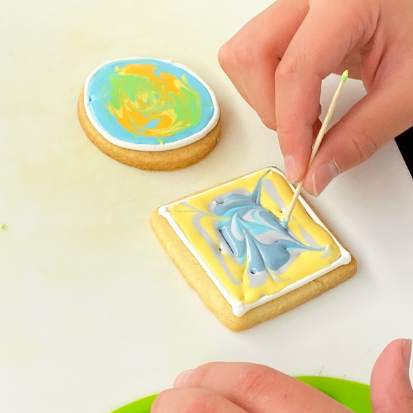 Kids flooding icing decorating sugar cookies with Adell Shneer on eatlivetravelwrite.com