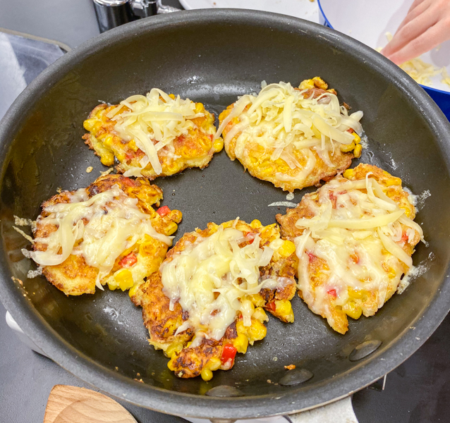 Pan frying Cheesy Corn Cakes with Arugula with Afrim Pristine from Cheese Boutique on eatlivetravelwrite.com