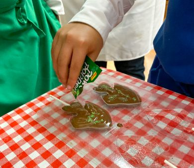 Kids filling chocolate molds with squeeze bottles with Kerry Beal on eatlivetravelwrite.com