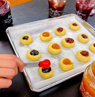 Kids make thumbprint jam drop cookies on eatlivetravelwrite.com