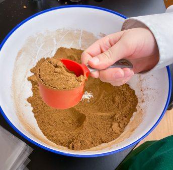 Kids making homemade Pumpkin Pie Spice from Gather by David Robertson on eatlivetravelwrite.com