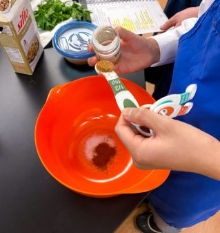 Kids measuring spices for Meatballs with Mushroom Gravy from Best of Bridge Comfort Food with Emily Richards on eatlivetravelwrite.com