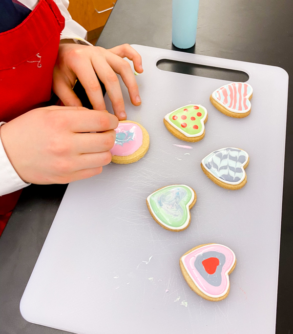Finishing up decorating sugar cookies with Adell Shneer on eatalivetravelwrite.com