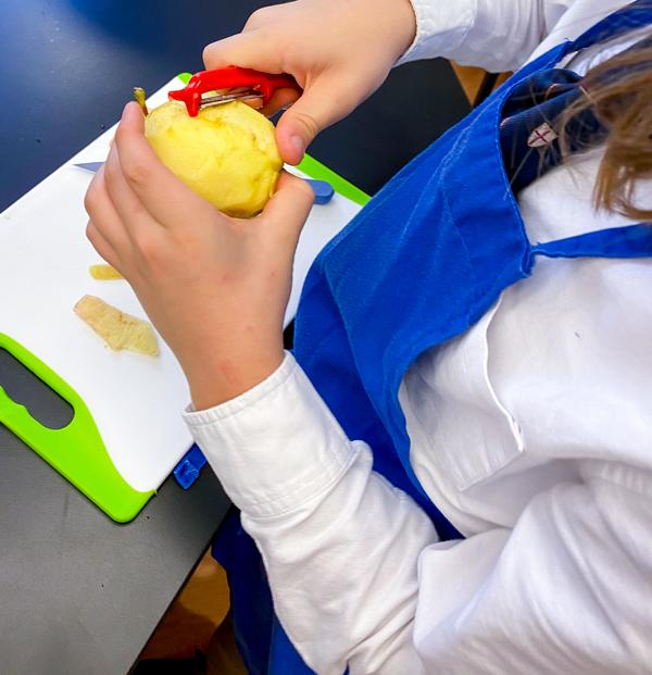 Kids peeling apples to make Apple Pie Waffles from Brunch Life with Matt Basile on eatlivetravelwrite.com