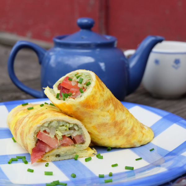Cheesy omelette wraps with bacon, lettuce, avocado and tomato