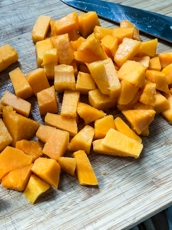 Chopped butternut squash to make one pan pasta with vegetables and meatballs on eatlivetravelwrite.com