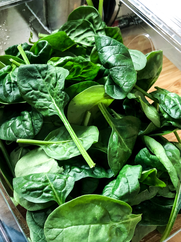 Baby spinach leaves to make one pan pasta with vegetables and meatballs on eatlivetravelwrite.com