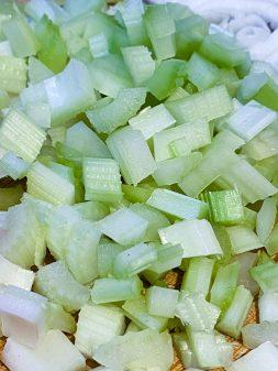 Chopped celery for making soupe Joumou on eatlivetravelwrite.com