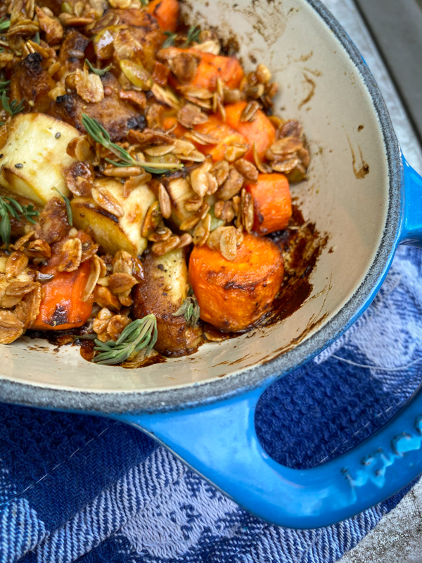 Granola-topped squash and root vegetable gratin from Everyday Dorie in a blue Le Creuset dish
