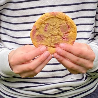 Girl holding Ruby chocolate chip cookies