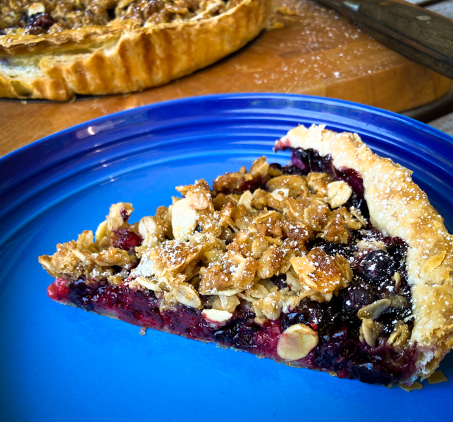 Slice of Mixed Berry Crumble Tart