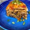 Layered taco bake on a blue plate