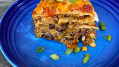 Layered taco bake on a blue plate
