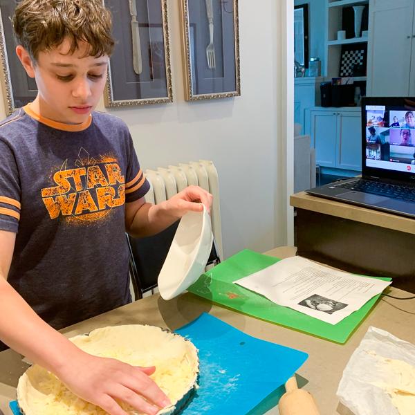 Kids making berry tart