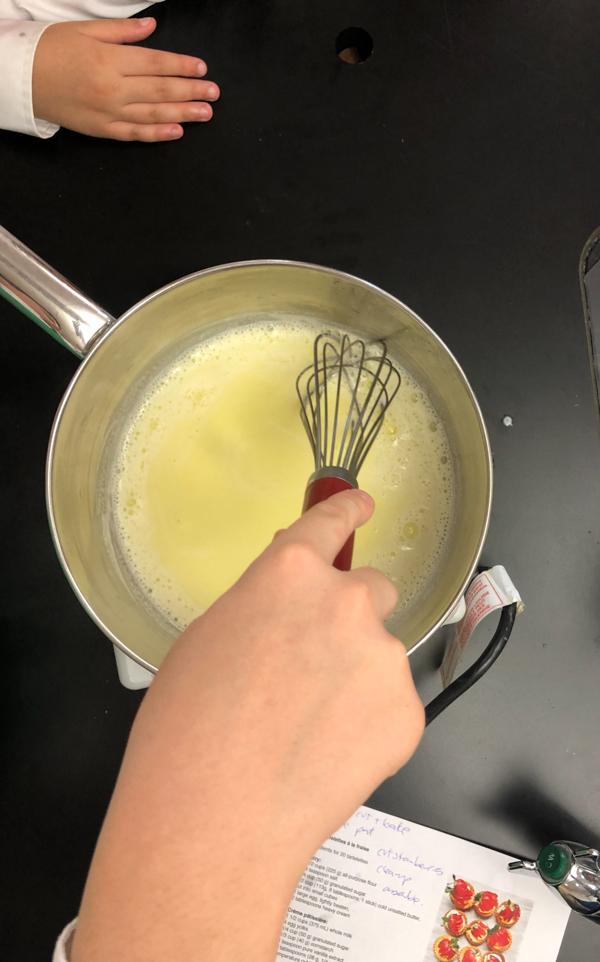 Kids making crème pâtissière
