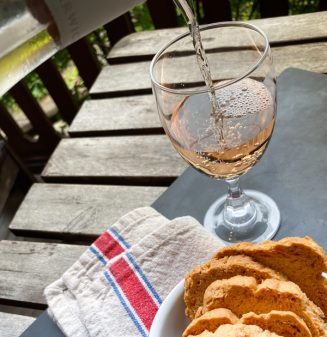 Pouring a glass of wine ans serving it with Parm Toasts from Dorie Greenspan's Dorie's Cookies