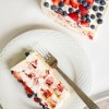 Slice of No-Bake Strawberry Cheesecake Icebox Cake on a plate with a fork