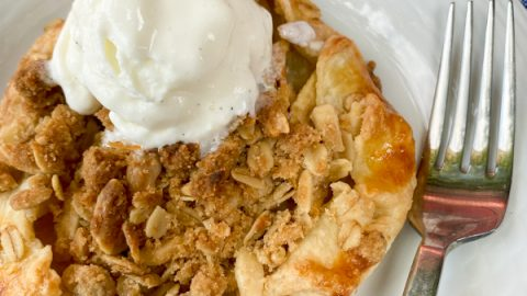 Apple crumble galette with ice cream on a plate