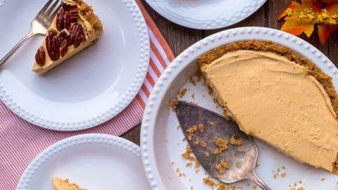 Slices of Frozen No-Bake Pumpkin Mousse Cheesecake with Caramelized Pecans