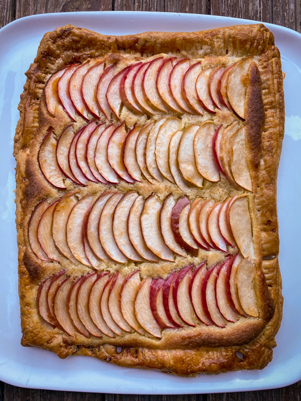 Easy puff pastry apple galette on a white serving plate