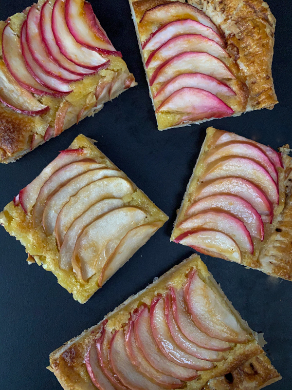 Slices of Easy puff pastry apple galette on a black surface