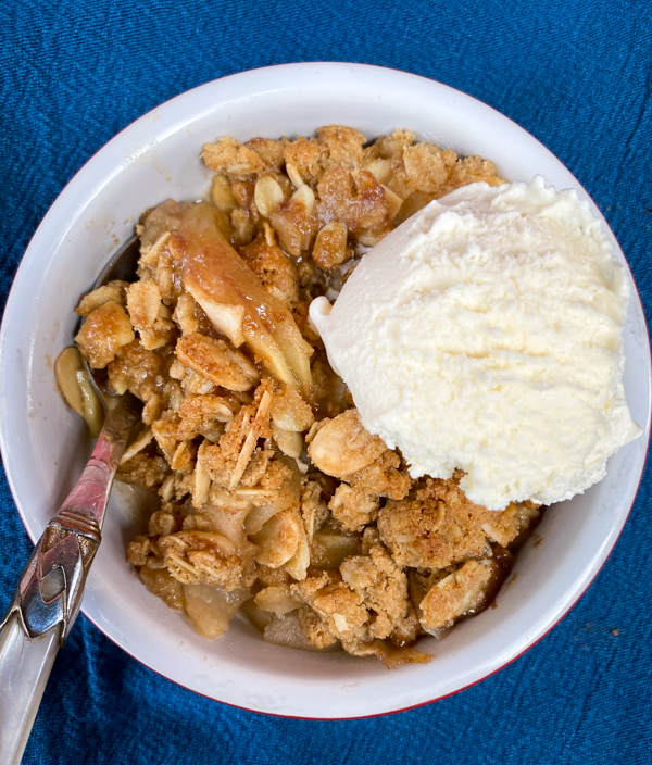 Individual serve of Salted Caramel Apple Crumble with ice cream