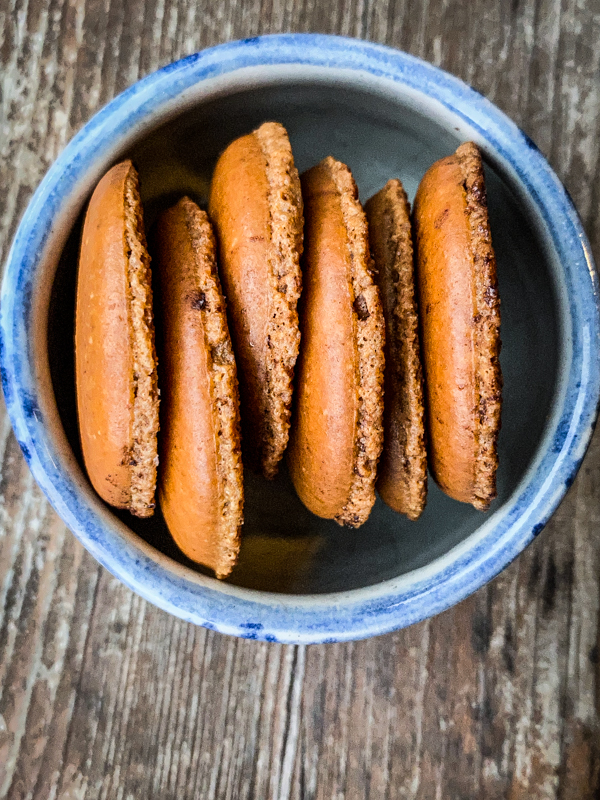 Dorie Greenspan's macaron biscotti in a small blue bowl