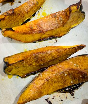 Roasted Acorn Squash Wedges from Dorie Greenspan's Everyday Dorie on a roasting pan