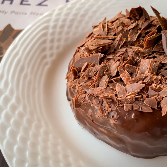 Tiny version of Dorie Greenspan's Carrement Chocolate Cake on a white plate