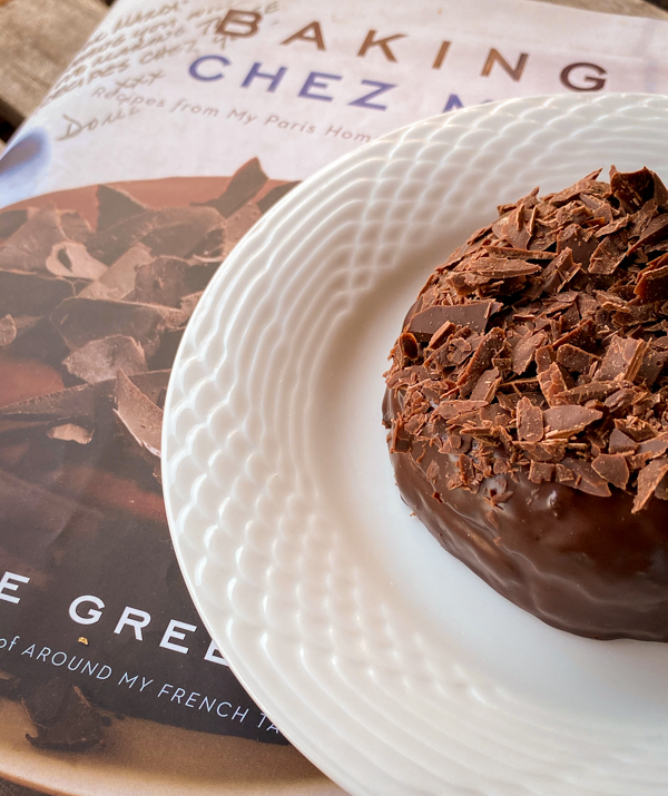 Close up of Carrement Chocolat cake on a copy of Dorie Greenspan's Baking Chez Moi