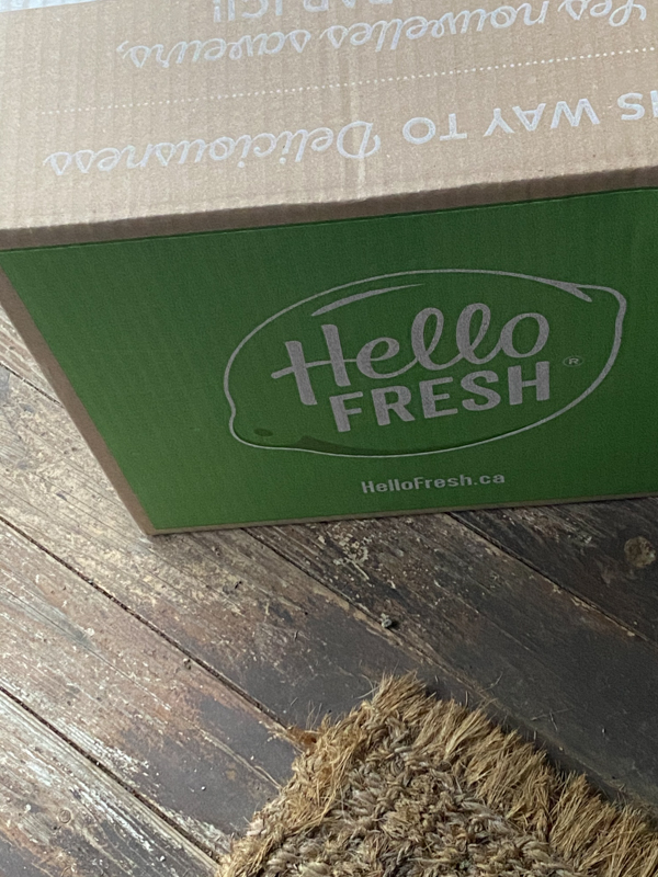 Hello Fresh box on a porch.