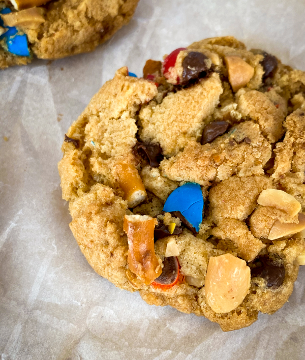 "Closeup of a ""Game Day"" cookie with peanuts, M&Ms, pretzels and chocolate chips."
