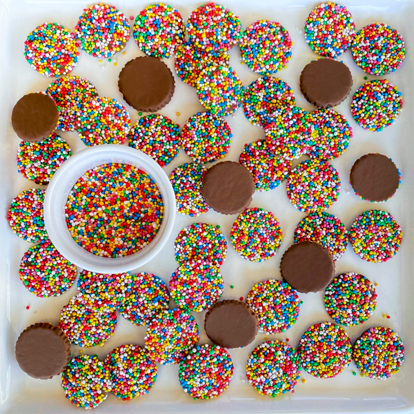 Homemade freckle candies on a white serving place.