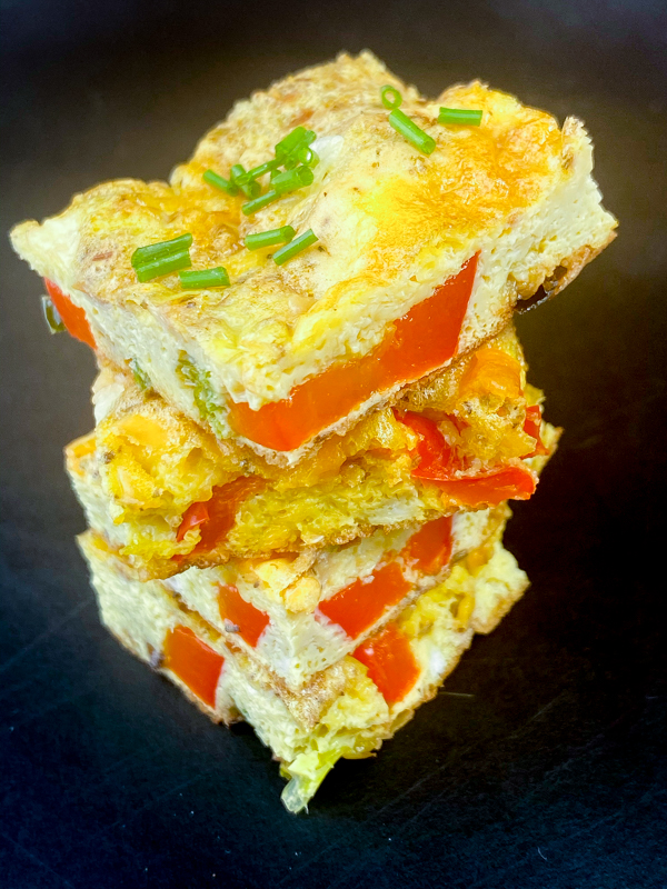 Slices of Western Frittata from Everyday Dorie stacked on a serving tray.