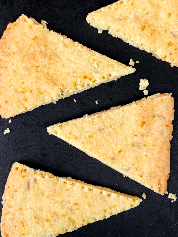 Dorie Greenspan's Fennel-Orange Shortbread Wedges on a black serving tray.
