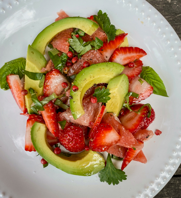 Spring Avocado and Berry Salad from Everyday Dorie on a white plate.
