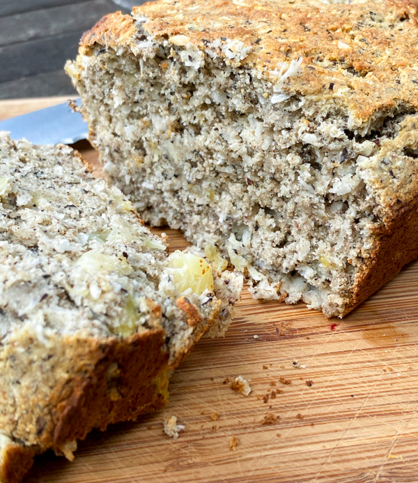 Cross section of Banana, pineapple and coconut bread on a cutting board.